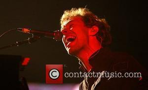 Chris Martin of Coldplay perform live at Earls Court London, England - 12.12.05