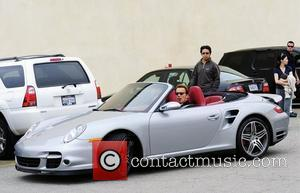 Arnold Schwarzenegger and his son Christopher leaving a restaurant after having lunch with their family in Brentwood Los Angeles, California...
