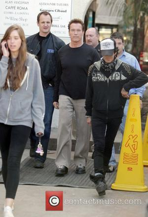 Arnold Schwarzenegger and His Daughter Christina Leaving Cafe Roma After Having Lunch.