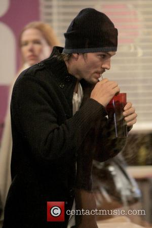 Ashton Kutcher takes a sip of his drink at the 2009 Sundance Film Festival, Day 2 Park City, Utah -...