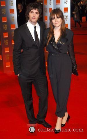 Jim Sturgess and guest The Orange British Academy Film Awards (BAFTA) 2009 - Outside Arrivals London, England - 08.02.09
