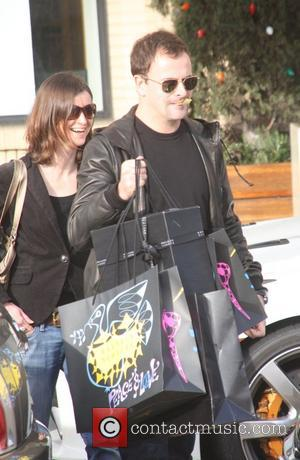 Jonny Lee Miller and wife Michele Hicks doing some last minute Christmas shopping at Barney's of New York Los Angeles,...