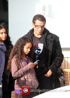 Mario van Peebles doing some last minute Christmas shopping with his family at Barney's of New York Los Angeles, California...