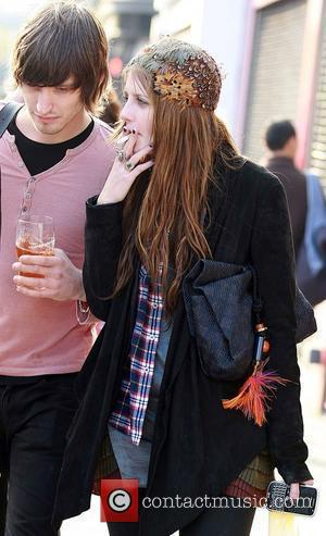 Mischa Barton, Wearing A Feathered A Headpiece and Walking To The Hawley Arms Pub After Enjoying A Day Out In Primrose Hill