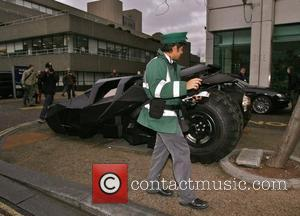 A Parking attendant thinks long and hard about ticketing the Batmobile for illegally parking The Batmobile pays a visit to...