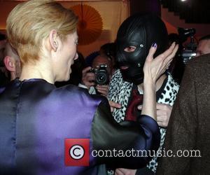 Tilda Swinton and Masked Man