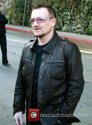 U2 frontman Bono leaves the Chateau Marmont hotel before his band's gig at Capitol Records Tower as part of their...