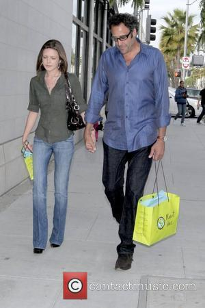 Brad Garrett holding hands with his girlfriend as they walk down Beverly Drive after shopping at Planet Blue Los Angeles,...