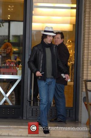 Brandon Davis returns to his dented car after shopping at Barneys in Beverly Hills Los Angeles, California - 15.12.08