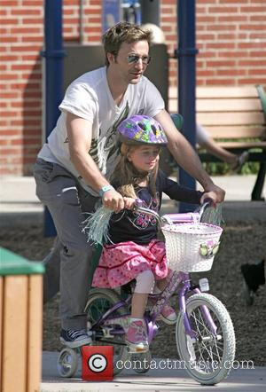 Actor Breckin Meyer plays the doting father as he spends the day with his daughter in the park before treating...