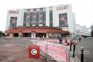 Workmen lay the red carpet and the final touches are made around Earls Court arena for the 2009 BRIT awards...