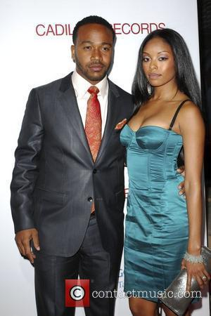 Columbus Short and Guest The Los Angeles premiere of 'Cadillac Records' held at The Egyptian Theater - Arrivals Hollywood, California...