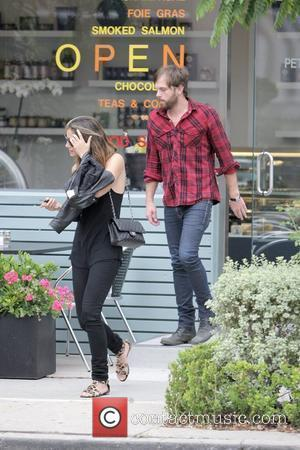Caleb Followill of rock band Kings of Leon eats dinner with a female companion at Petrossian restaurant Los Angeles, California...