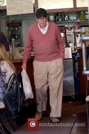 Carl Reiner Emmy award winning actor picking up takeout from Judi's Deli while wearing a black cap Los Angeles, California...