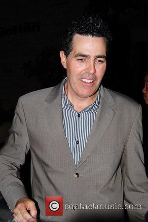 Adam Carolla signs autographs for waiting fans outside the Geffen Playhouse. Los Angeles, California - 19.05.09