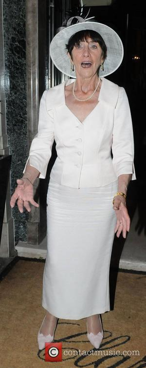 June Brown outside Claridge's hotel, where a party for Samatha Janus' wedding was held London, England - 17.05.09