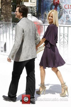 Jim Carrey and Jenny McCarthy 2009 Cannes International Film Festival - Day 6 'A Christmas Carol' - photocall held at...