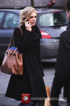 Chelsy Davy chats on her mobile phone as she  walks back to her student flat after a morning at...