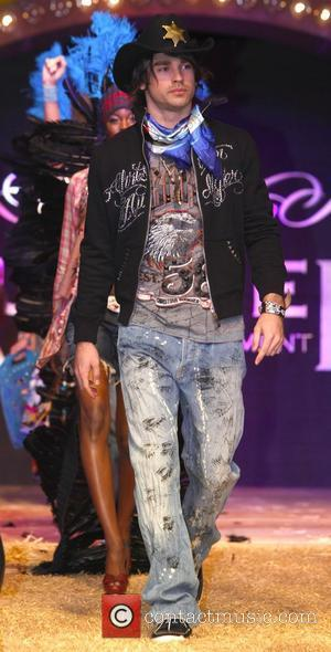 Justin Gaston World famous Fashion designer Christian Audigier presents his trade show 'When I Move You Move' held at Ceasar's...
