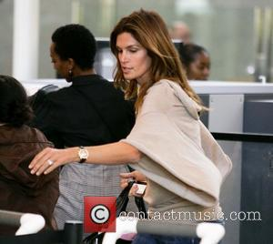 Supermodel Cindy Crawford passes through security to board a flight from LAX to New York Los Angeles, California - 04.05.09