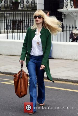 Claudia Schiffer makes her way home after taking her children to school London, England - 12.05.09