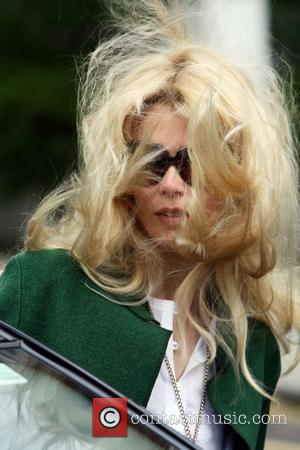 Claudia Schiffer with windswept hair makes her way home after taking her children to school London, England - 12.05.09