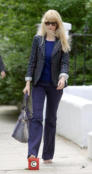 Claudia Schiffer drops her children off at school wearing sunglasses on an overcast day in London London, England - 18.05.09