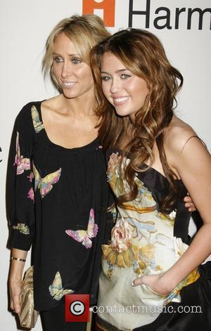 Tish Cyrus and Miley Cyrus Clive Davis and The Recording Academy present the Annual Pre-Grammy Gala  Beverly Hills, California...
