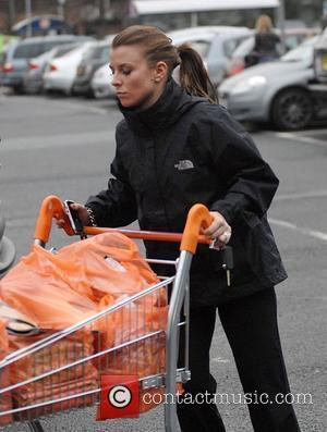 Coleen Rooney stocking up on food for the festive period at her local supermarket  Liverpool, England - 23.12.08