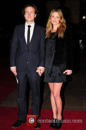 Rafe Spall and Elize du Toit UK film premiere of 'The Damned United' held at Vue Leicester Square London, England...