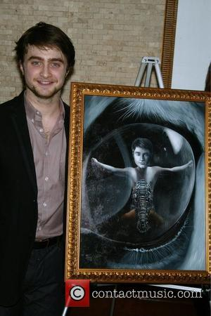 Daniel Radcliffe receives a portrait on Tony's di Napoli Wall of Fame to commemorate his performances in the Broadway play...