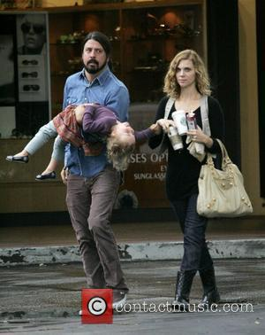 Dave Grohl  has a stroll in Bel-Air with daughter Violet Maye Grohl and second wife Jordym Blum  Los...