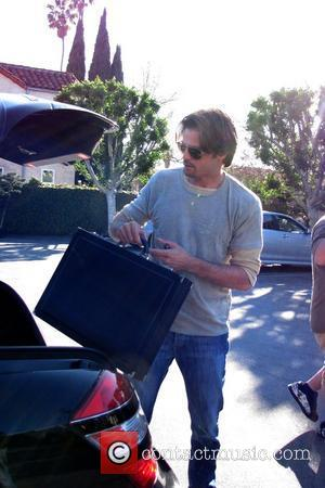David Charvet brings his briefcase to Fred Segal where he plays backgammon with a friend  Los Angeles, California -...