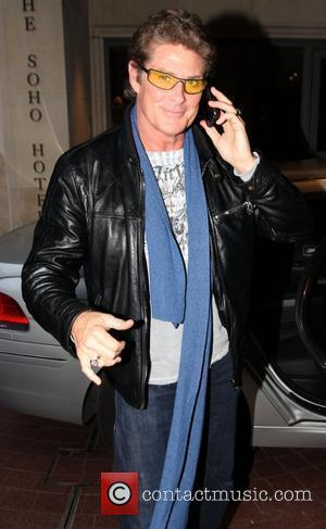 David Hasselhoff arriving at his hotel wearing yellow tinted glasses and speaking on his mobile phone London, England - 19.01.09