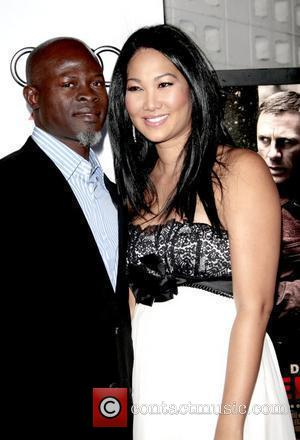 Djimon Hounsou and Kimora Lee Simmons  AFI Film Festival 2008 - Premiere of 'Defiance' - held at the Arclight...