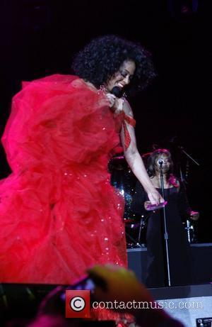 Diana Ross  teases a fan by taking his camera phone and pretends to step on it during a performance...