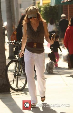 Dina Meyer out and about in Beverly Hills Beverly Hills, California - 18.03.09