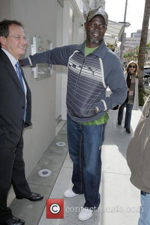 Djimon Hounsou is in high spirits walking to Martin Katz jewelry store after leaving Prego restaurant in Beverly Hills Los...