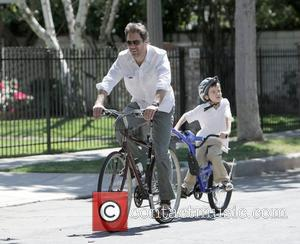 Actor Dougray Scott rides a tandem bicycle with his son in Toluca Lake Los Angeles, California - 05.04.09