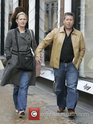 Radio DJ Neil Fox and his wife shopping on Bond Street  London, England - 01.09.07