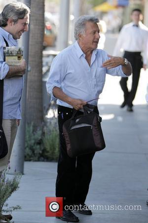 Dustin Hoffman leaving Il Pastaio restaurant on Canon Drive in Beverly Hills after having lunch with a male friend Los...