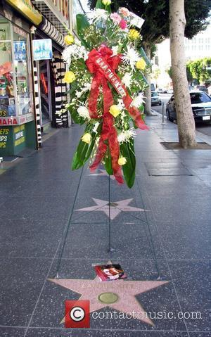 Flowers Are Laid In Tribute Along The Hollywood Walk Of Fame For Eartha Kitt