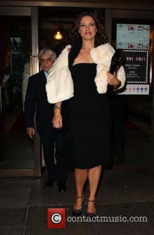 Bernie Ecclestone and Slavica Ecclestone  departing the launch party for Petra Ecclestone's Form Menswear at Harrods London, England -...