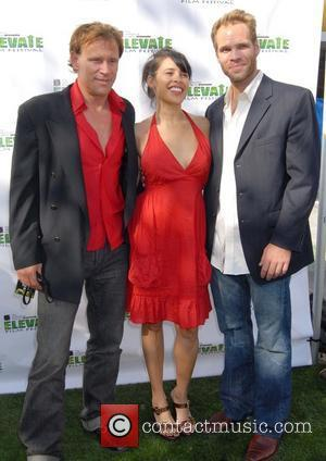 Mark Harris, Carmen Perez and guest 'All Tribes Unite' at the Elevate Film Festival - arrivals Los Angeles, California -...