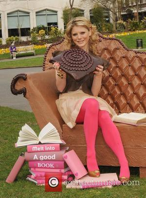 Emilia Fox  poses with a 250kg edible chocolate sofa in Victoria Embankment Gardens to launch Galaxy Irresistible Reads campaign...