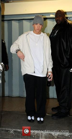 Eminem showing his middle finger to photographers when leaving a recording studio  London, England - 12.05.09