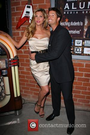 Candis Cayne, Rib Hillis ALUMI Media Group charity event hosted by Extreme Makeover: Home Edition's Eduardo Xol, held at Gibson...
