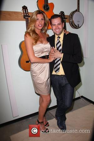 Candis Cayne and Eduardo Xol