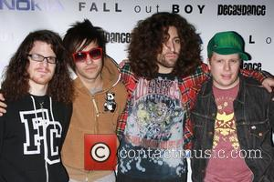 Andy Hurley, Pete Wentz, Joe Trohman and Patrick Stump Fall Out Boy perform at the Nokia Theatre Times Square to...
