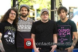 Andy Hurley, Joe Trohman, Patrick Stump and Pete Wentz of Fall Out Boy pose for photographs after their performance on...